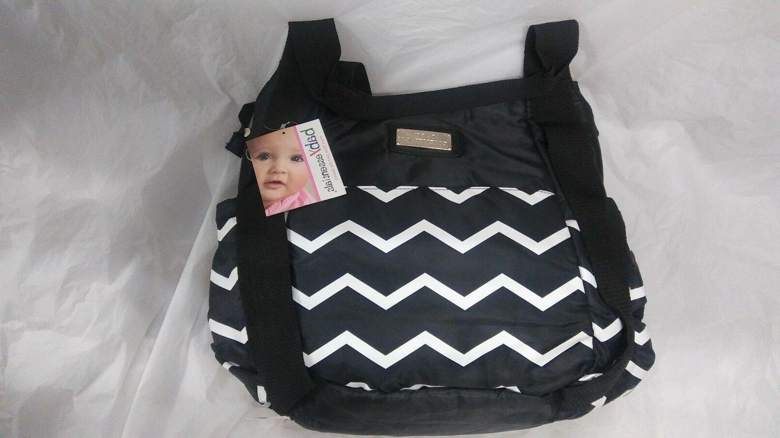 black striped diaper bag and changing pad